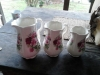 Set of three antique rose jugs